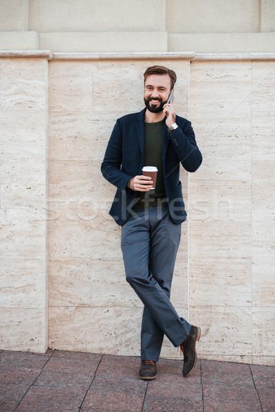 Portrait souriant homme tasse de café Photo stock © deandrobot