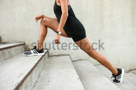 Cropped image of a fitness woman running up the stairs Stock photo © deandrobot