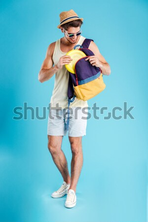 Full length portrait of a funny young shirtless man Stock photo © deandrobot