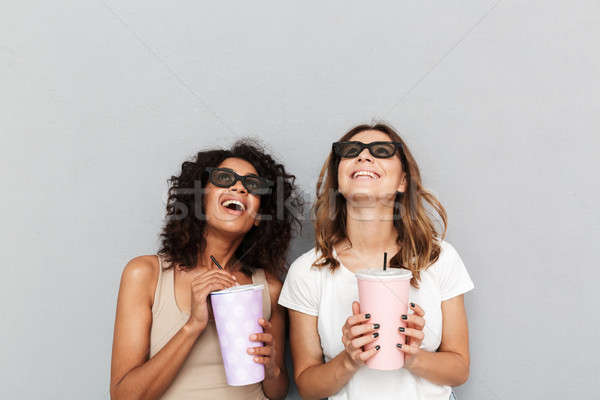 Portrait of two smiling young women in 3d glasses Stock photo © deandrobot