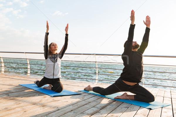 Mosolyog fiatal sportok pár gyakorol jóga Stock fotó © deandrobot