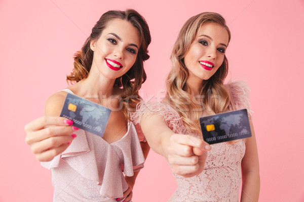 Two happy women in dresses posing together Stock photo © deandrobot
