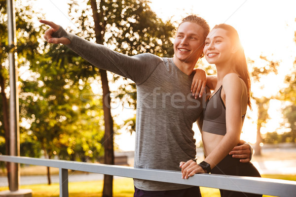 Image of beautiful caucasian sporty man and woman 20s in tracksu Stock photo © deandrobot