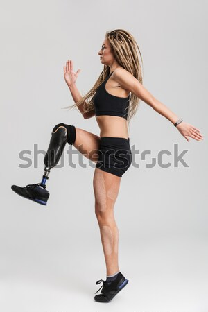 Sports woman having pain in knee Stock photo © deandrobot