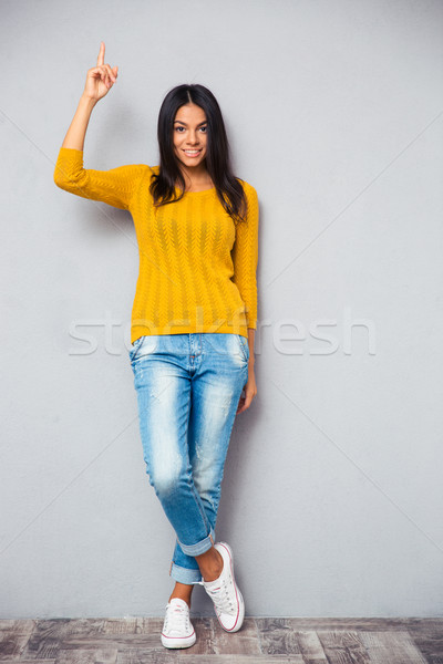 Stock photo: Beautiful happy woman showing finger up