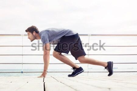 Sportok férfi kezdet pozició kint portré Stock fotó © deandrobot