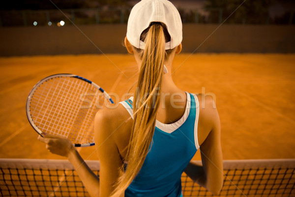 Woman playing in tennis outdoors Stock photo © deandrobot