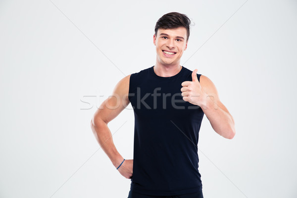 Stock photo: Smiling sports man showing thumb up