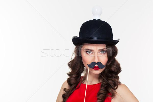 Grappig gekruld vrouw belachelijk zwarte hoed Stockfoto © deandrobot