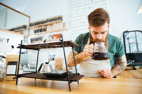 Barista smelling coffee Stock photo © deandrobot