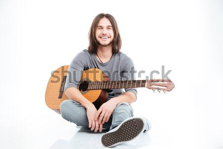 Handsome confident young man with acoustic guitar Stock photo © deandrobot