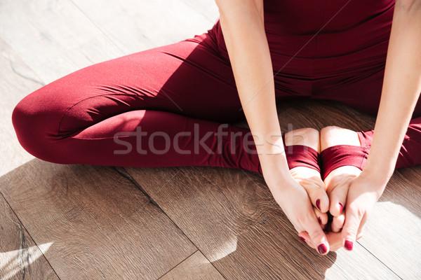 Mains jambes jeune femme yoga pieds nus Photo stock © deandrobot