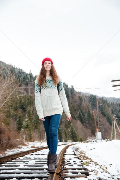 Woman walking on railway  Stock photo © deandrobot