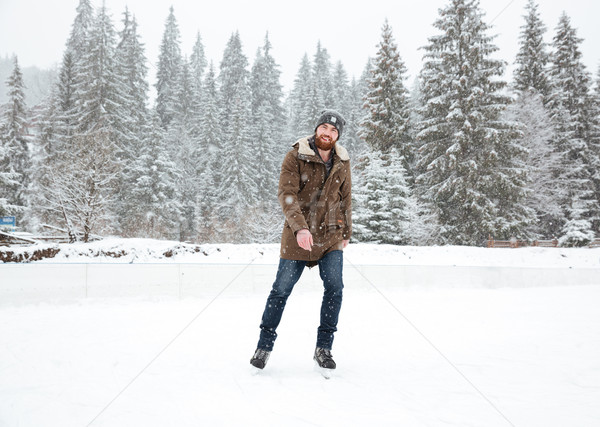 Young man ice skating outdoors  Stock photo © deandrobot