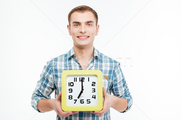 Portrait of happy attractive young man with big clock Stock photo © deandrobot