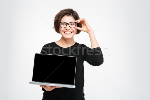 Sorrindo computador portátil tela isolado branco Foto stock © deandrobot