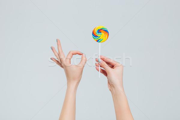 Feminino mãos pirulito Foto stock © deandrobot