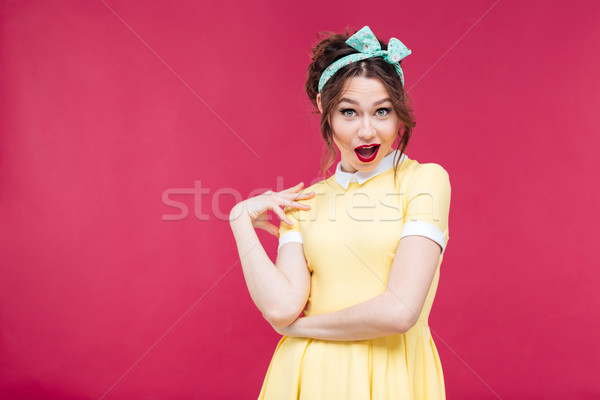 Amazed happy pinup girl in yellow dress Stock photo © deandrobot