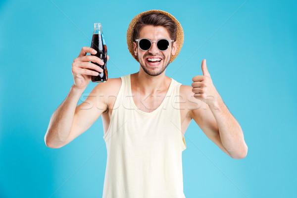Alegre hombre botella sosa Foto stock © deandrobot