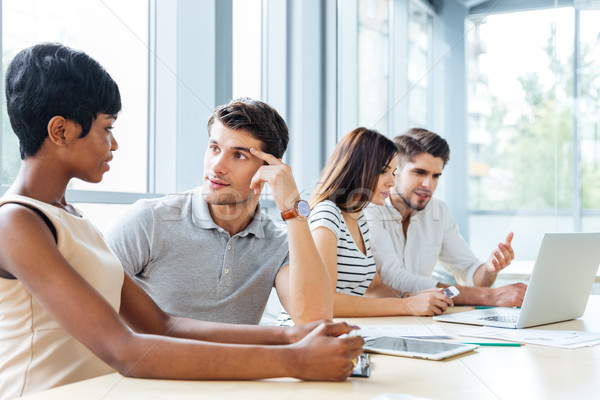 üzletemberek ül beszél iroda csoport fiatal Stock fotó © deandrobot