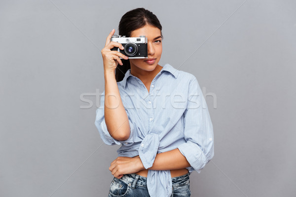 Cheerful woman making photo with camera Stock photo © deandrobot