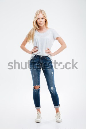 Beautiful smiling girl with her arms on hips Stock photo © deandrobot
