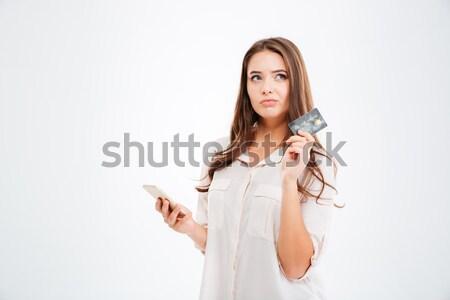 Foto stock: Pensativo · mulher · cartão · de · crédito · isolado