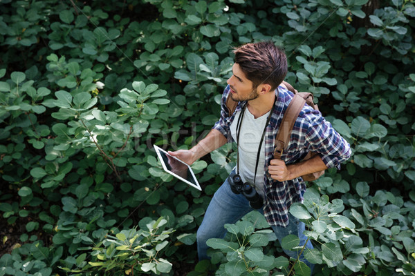 Top view of young man in forest Stock photo © deandrobot