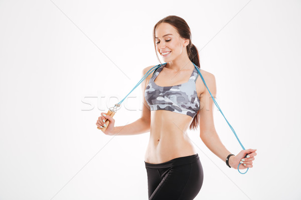 Fitness woman with skipping rope Stock photo © deandrobot