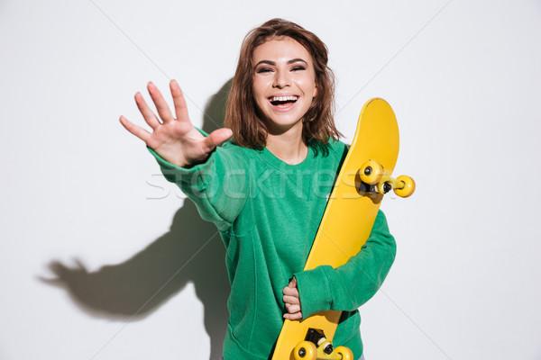 Dość łyżwiarz pani deskorolka zdjęcie zielone Zdjęcia stock © deandrobot