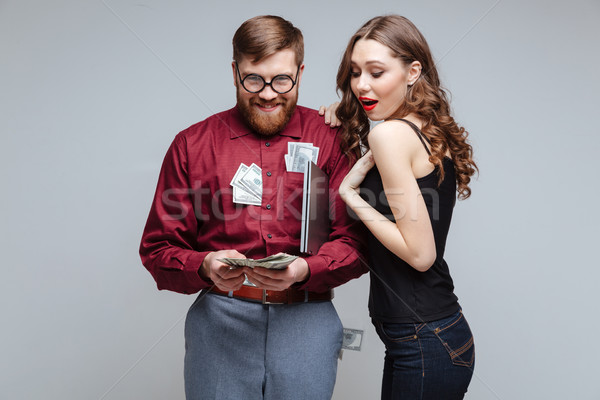 Cunning Male nerd with interested girl Stock photo © deandrobot