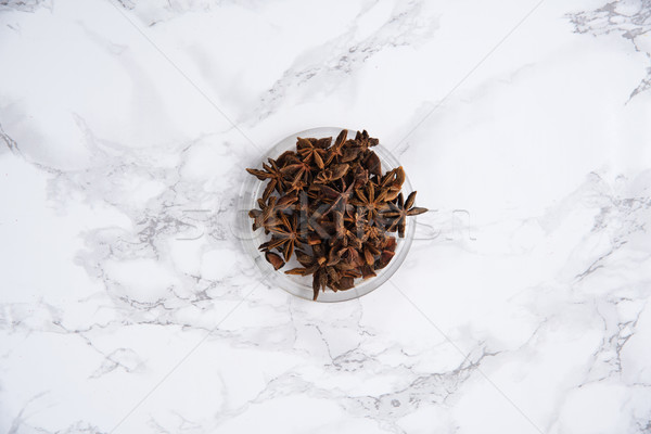 Chinese star anise or badiam seeds in a bowl Stock photo © deandrobot