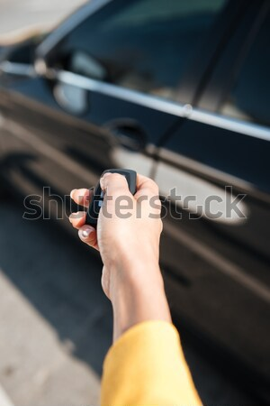 Woman hand holding keys and closing door of her car Stock photo © deandrobot