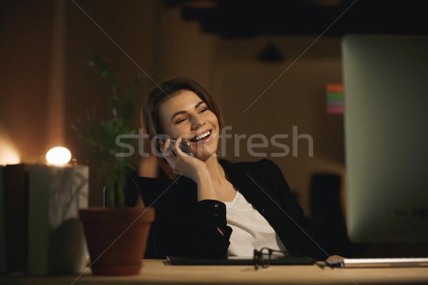 Derűs fiatal nő designer beszél telefon kép Stock fotó © deandrobot