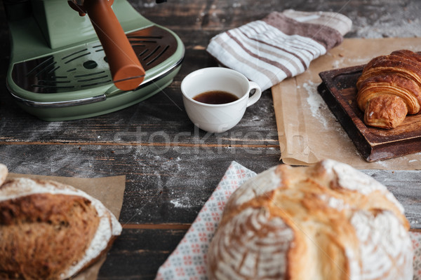 Cropped image of a lot of bread on table Stock photo © deandrobot