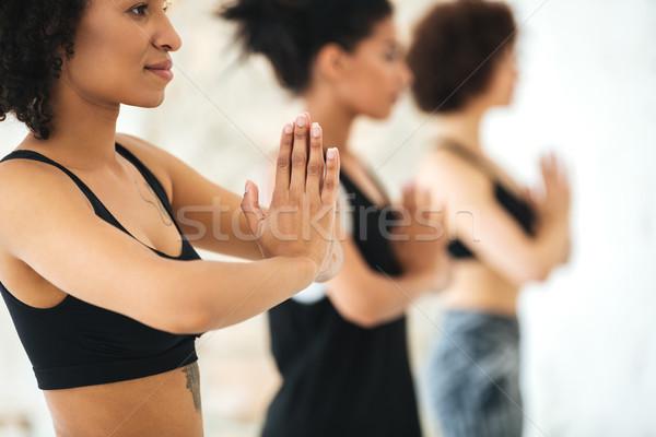 Közelkép multikulturális csoport nők gyakorol jóga Stock fotó © deandrobot