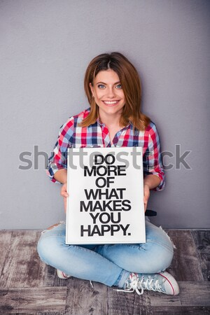 Cheerful woman holding laptop with blank screen isolated Stock photo © deandrobot