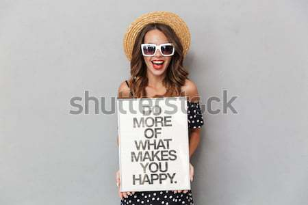 Angry woman feminist with poster looking camera Stock photo © deandrobot