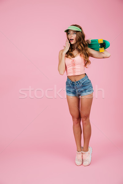 Full length portrait of an astonished woman in summer clothes Stock photo © deandrobot