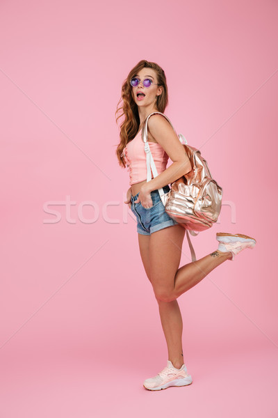 Full length portrait of amazed readhead woman in summer wear wit Stock photo © deandrobot