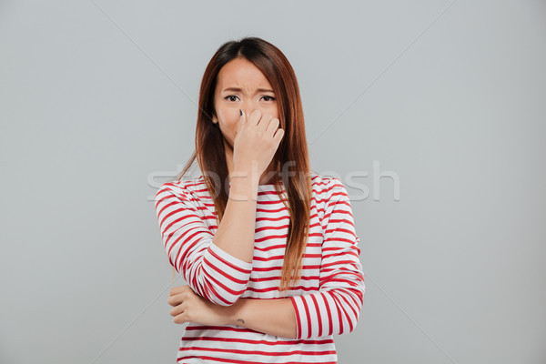 Portrait of a an upset disappointed asian woman crying Stock photo © deandrobot