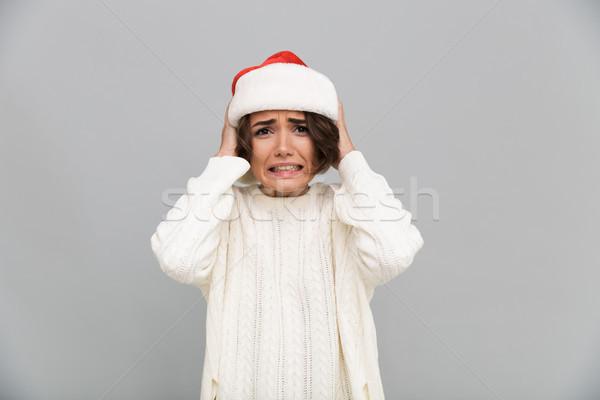 Portret verward onzeker meisje christmas hoed Stockfoto © deandrobot