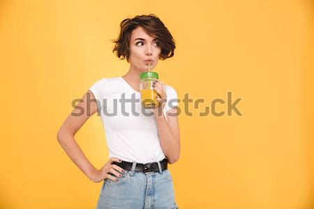 Portrait of a young attractive woman dressed in denim jacket Stock photo © deandrobot
