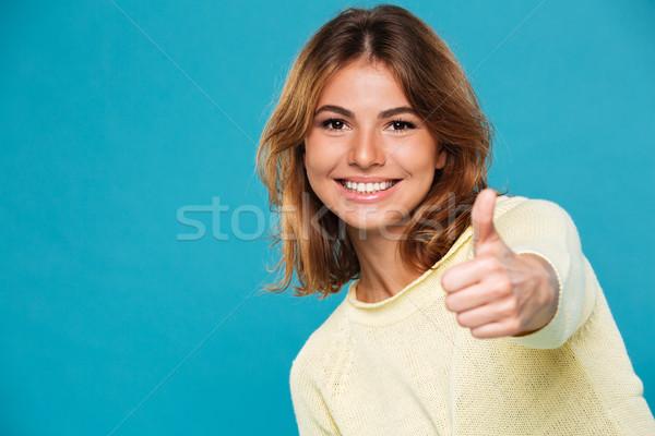 Podniecony szczęśliwy młodych uśmiechnięta kobieta Zdjęcia stock © deandrobot