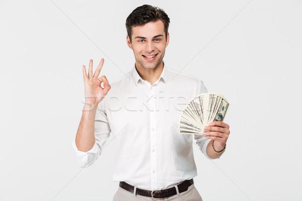 Portrait of a confident smiling man Stock photo © deandrobot