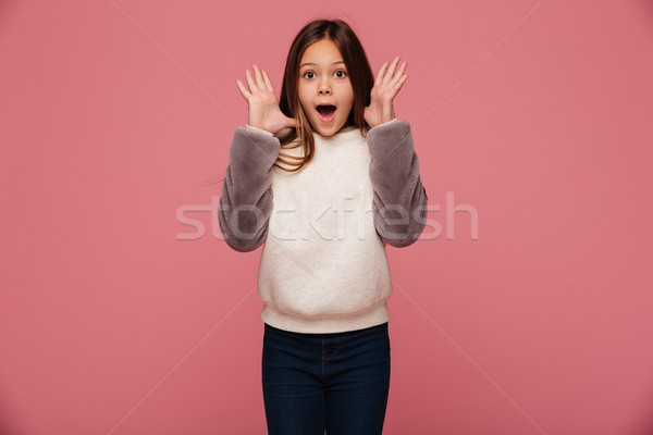 Shocked happy girl in casual clothes looking camera with opened mouth isolated Stock photo © deandrobot