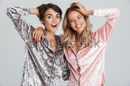 Picture of Two Smiling girls posing together and making selfie Stock photo © deandrobot