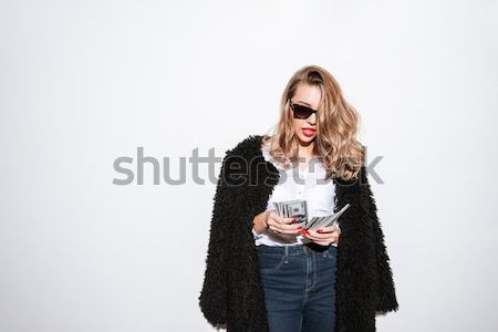 Surprised young pretty woman holding fake moustache Stock photo © deandrobot