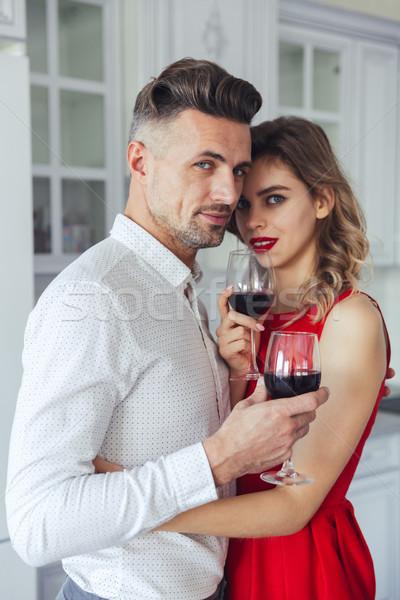 Portrait of an attractive romantic smart dressed couple Stock photo © deandrobot