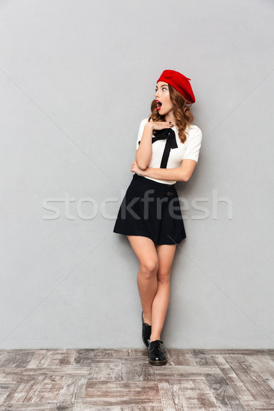 Full length portrait of an astonished schoolgirl Stock photo © deandrobot